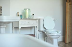 Why might you need a raised toilet seat?